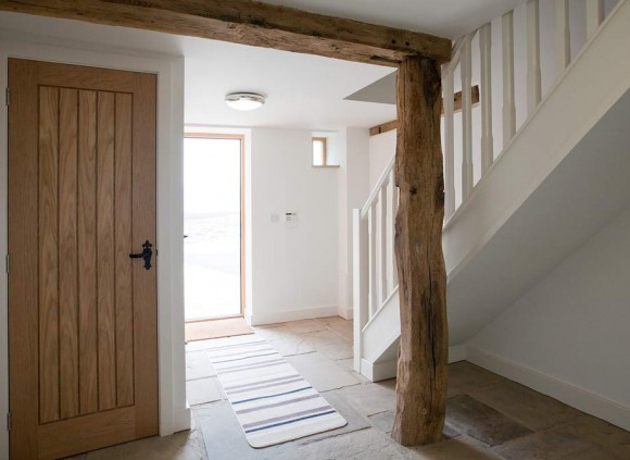 The entrance to this holiday cottage shows off the mix of traditional and contemporary features.