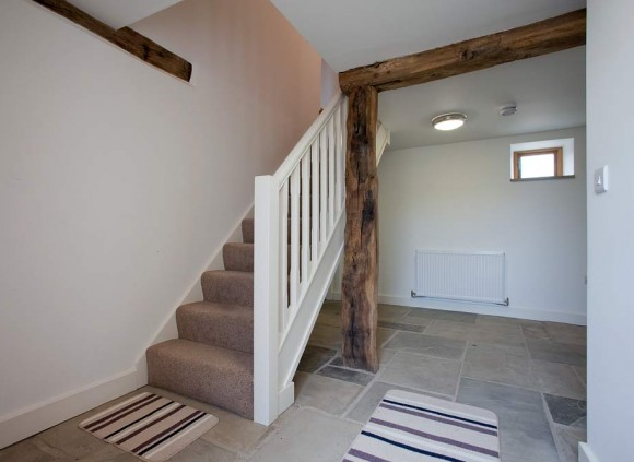 The stairs lead to a further 3 bedrooms on the first floor.