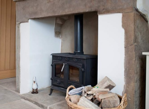 A traditional York stone floor and wood burning stove enhance this traditional cottage.