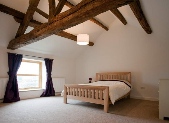Bedroom showing feature oak beams.