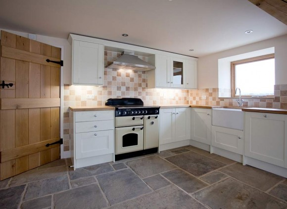 The open plan kitchen features a York stone flagged floor.
