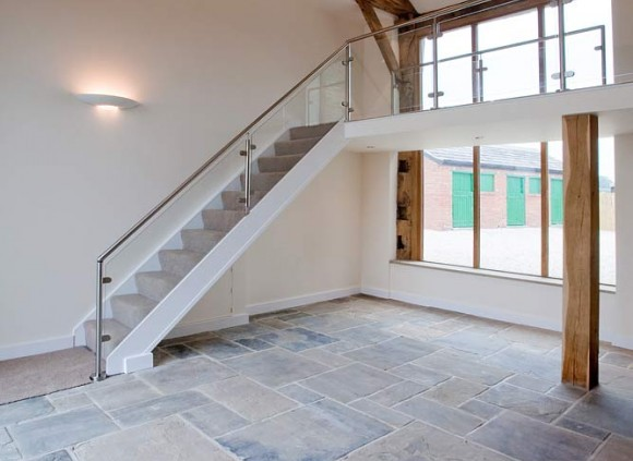 An open staircase leading to galleried landing overlooking the spacious living area below.