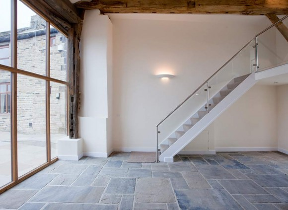 Open staircase leading upstairs from the large, open plan living space on the ground floor.